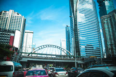 Building in the city and traffic jam on Sathorn road Royalty Free Stock Images