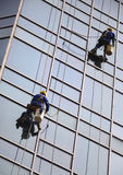 Building Cleaning,Dustman. Dustman cleaning the building wall Stock Photos