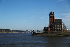 Building with a clock in the port of Hamburg, Germany Royalty Free Stock Photography