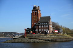 Building with a clock in the port of Hamburg, Germany royalty free stock photos