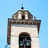 building  clock tower in italy europe old  stone and bell Royalty Free Stock Image