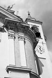 building  clock tower in italy europe old  stone and bell Stock Photo