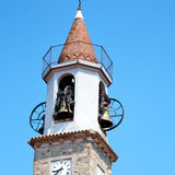 building  clock tower in italy europe old  stone and bell Stock Image
