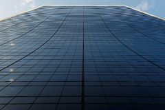 Building with clouds and lines Royalty Free Stock Photography