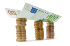Building of coins and euro bank note Royalty Free Stock Photos