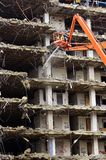Building Collapsing or Falling Down. Building collapsing or being demolished with debris falling down Royalty Free Stock Photos
