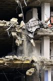 Building Collapsing or Falling Down. Building collapsing or being demolished with debris falling down Royalty Free Stock Photo