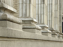 Building column bases. Row of bases of square columns on heritage building facade stock image