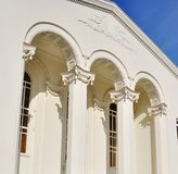 Building with columns. On blue sky background Royalty Free Stock Image