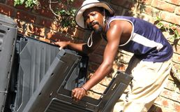 Building a compost bin. African american man building a compost bin to create a green environment with the yard and kitchen waste to fertilize the plants Stock Images
