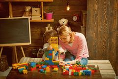 Building concept. Mother and son play with building blocks. Mother and child build structure with toy bricks. Building. Social skills and building trust stock photos