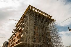 Building concrete and brick block on construction site close up shot. royalty free stock photography