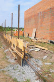 Building concrete foundation for new fence. Stock Photos