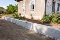 Building concrete foundation for wooden rural fence. Foundation for fence. Foundation for fence. Building concrete foundation for wooden rural fence royalty free stock images