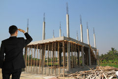 Building construct site. Businessman in building construct area cement pillar and wood Stock Photos