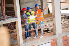 Building constructers planning future building Stock Photography
