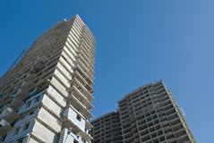 Building construction. Two tall buildings under construction Stock Photo