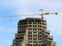 Building construction. Unfinished building construction and crane Royalty Free Stock Image