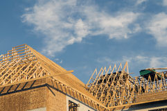 Building Construction. Frame construction of a large building with copy space in the blue sky Royalty Free Stock Photography