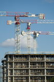 Building construction. Construction of a tall modern office building stock photography