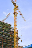 Building construction. Building and yellow construction crane with sky on background royalty free stock photography