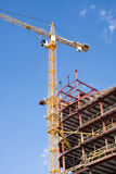 Building construction. Cranes and building construction on a background sky Royalty Free Stock Images