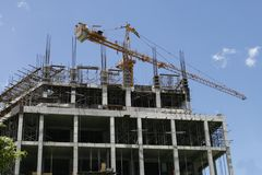 Building Construction. A large crane on top of a building under construction Stock Photo