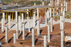 Building Construction Basement Floor Columns. Buiding construction site first floor basement concrete steel columns and floor supports structure steel materials Royalty Free Stock Photography