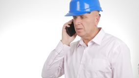 Confident Engineer Image Talking Business to Cellphone stock photos