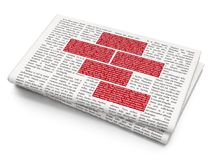 Building construction concept: Bricks on Newspaper background Royalty Free Stock Images