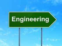 Building construction concept: Engineering on road sign background Royalty Free Stock Photo