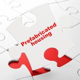 Building construction concept: Prefabricated Housing on puzzle background. Building construction concept: Prefabricated Housing on White puzzle pieces background Royalty Free Stock Image