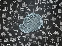 Building construction concept: Safety Helmet on School board background. Building construction concept: Chalk Blue Safety Helmet icon on School board background Stock Images