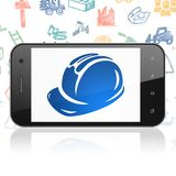 Building construction concept: Smartphone with Safety Helmet on display. Building construction concept: Smartphone with  blue Safety Helmet icon on display Stock Photos