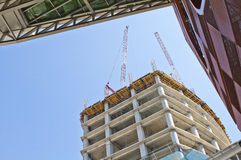 Building on construction. Concrete Highrise Construction Site in the city stock photography