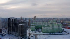 Building construction. Concrete structure. Monolithic frame construction. Yellow tower crane at the construction site. Protracted construction. Aerial view stock footage