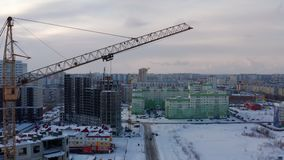 Building construction. Concrete structure. Precast-monolithic construction. Yellow tower crane at the construction site. Protracted construction. Aerial view stock footage