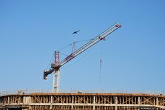 Building Construction Crane. A building under construction using a crane Stock Photos