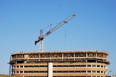 Building Construction Crane. A building under construction using a crane Royalty Free Stock Photos