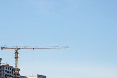 Building and construction crane. With blue sky background Stock Photos