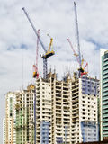Building Construction with Cranes on Top Stock Images