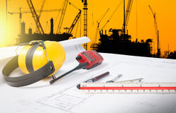 Building and construction equipment on blueprints. In offiae stock image