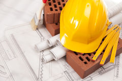 Building and construction equipment on white plans Royalty Free Stock Image