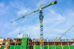 Building construction industrial with construction tower cranes Stock Images