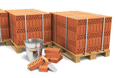 Building and construction industry concept. Group of wooden shipping pallets full of red bricks and construction tools isolated on white background Royalty Free Stock Image