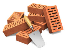 Building and construction industry concept. Group of red bricks and metal trowel isolated on white background Stock Photography