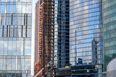 Building construction modern glass reflections Royalty Free Stock Image