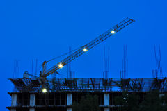 Building and construction in progress with crane. Royalty Free Stock Image