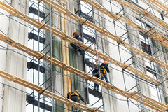 Building construction with scaffolding. Painting works at height royalty free stock photos