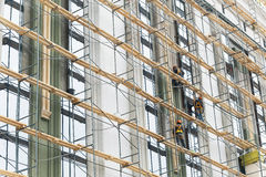 Building construction with scaffolding. Painting works at height stock photos